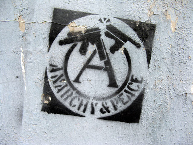 this is an image of a stencil that says: Anarchy & Peace