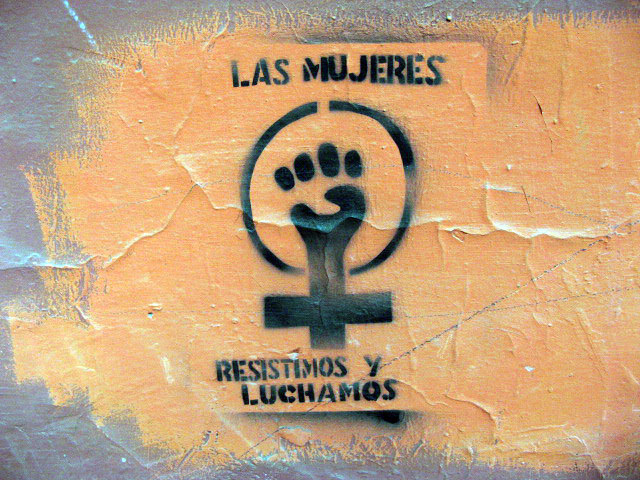 this is an image of a stencil that expresses: Las mujeres recistimos y luchamos (We women resist and struggle)