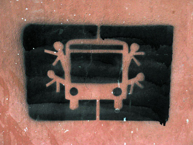 this is an image of a stencil that expresses: A crowded bus