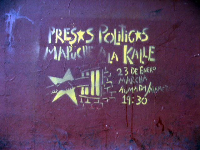 this is an image of a stencil that expresses: Presos politicos mapuches a la kalle (Mapuche political prisoners to the streets!)