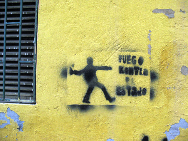this is an image of a stencil that expresses: fuego contra el estado (Fire against the state)