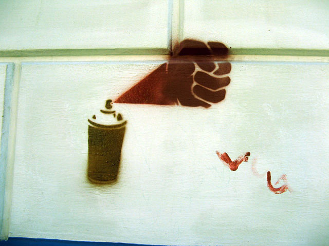 this is an image of a stencil expressing a punch comming out or a spraycan