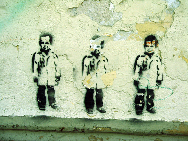 this is an image of a stencil expressing: three kids, triplets